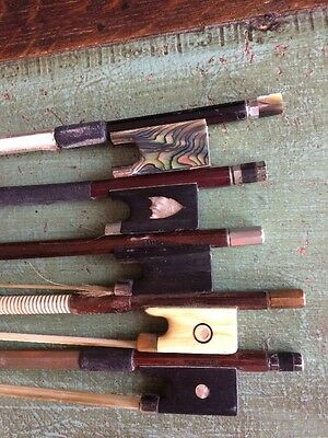 11 Old Violin Bows