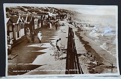 Early real photographic postcard of Frinton on Sea Essex bathing huts  1940's?