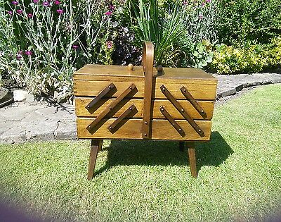 Vintage wooden cantilever sewing box on legs