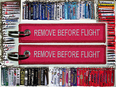 Keyring classic Remove Before Flight style tag in PINK keychain baggage label