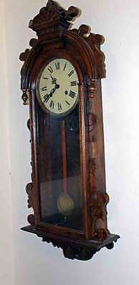 Antique Ornately Carved Case w/Pendulum and Key Chiming Wall Clock