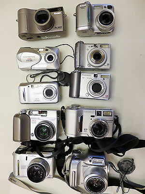 A lot of 10 digital cameras for parts or repair, almost free!