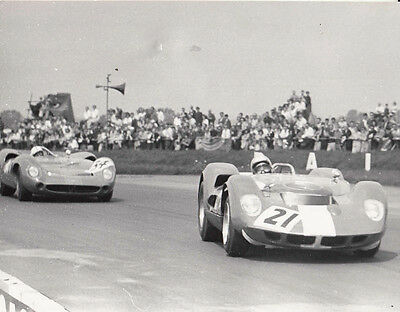 SPORTS CARS RACING, No.21 & FOLLOWED BY CAR No.34, PHOTOGRAPH.