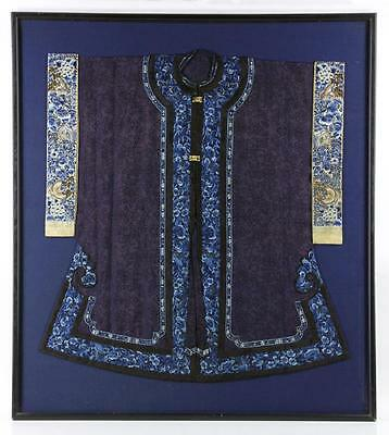 A Rare and Important Qing Dynasty Blue Ground Embroidered Floral Silk Robe.