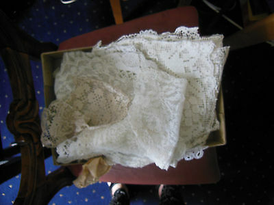 Acollection of around 50 vintage lace doilies of various sizes cream or white