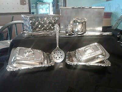 VINTAGE SILVER PLATED   LOT OF 8 PIECES. 2 small serving dishes  tongs etc.