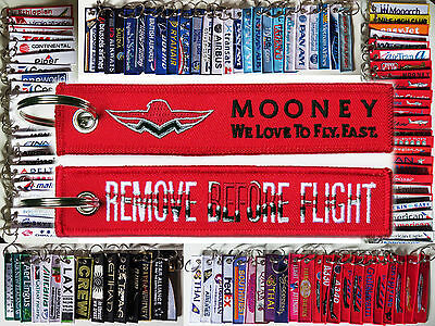 "Keyring MOONEY ""We love to fly fast"" in red Remove Before Flight keychain"
