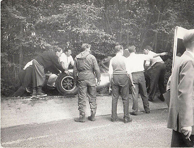 Crowd Around Crashed Single Seater Racing Car Witch Is Sitting On A Well, Photo