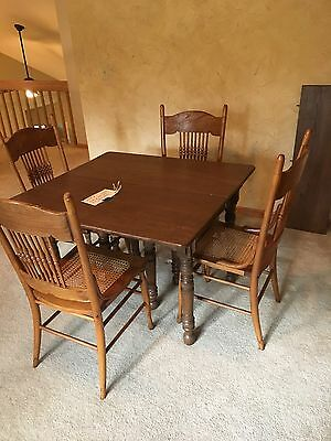Antique Table with 4 Pressback Caned Chairs