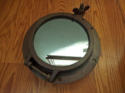 Vintage Heavy Brass Porthole With Mirrored One Way Glass And Brass Screen