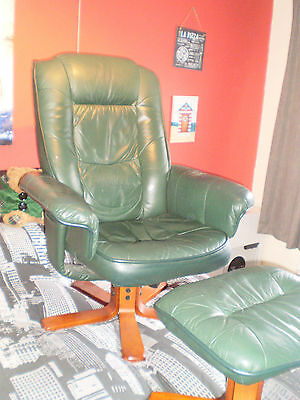Green leather swivel armchair and stool