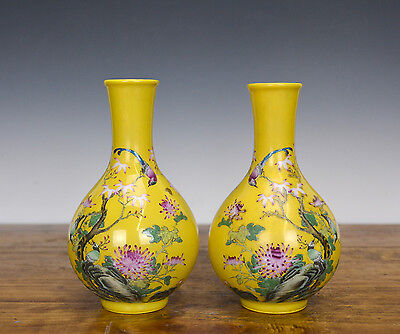 Pair of Chinese Fencai Floral Yellow Glazed Ground Mallet Form Porcelain Vase