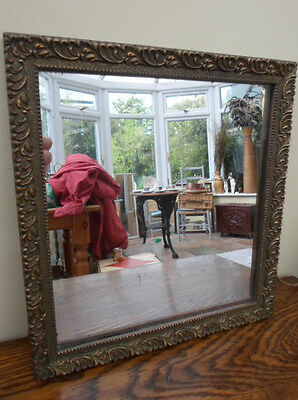 Vintage French ornate gilt mirror, intricately carved and beaded, gold coloured
