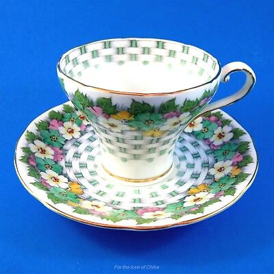 Corset Shaped and Basket and Floral Design Aynsley Tea Cup and Saucer Set