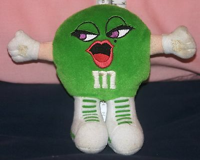 """Plush Green M&M Girl 6"""" no tags strap on back (for tube?)  fabric gripper hands"""