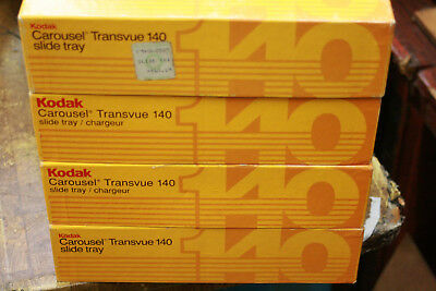10(ten)Kodak 140 slide carousel trays with retainers and boxes