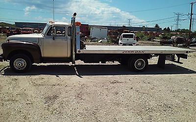 1947 Chevy cab on roll back tow truck on 1986 Ford 1 ton diesel