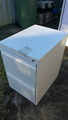 White metal filing cabinet with two drawers