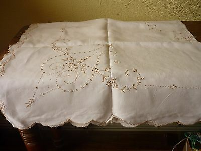 Ecru coloured embroidered linen table cloth