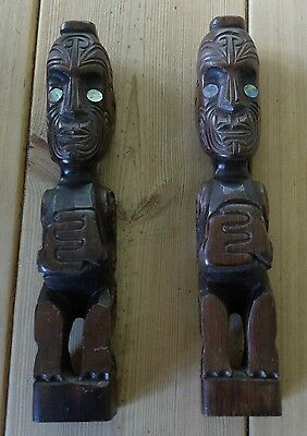 Two vintage Maori tiki wooden carved figures with shell eyes - signed