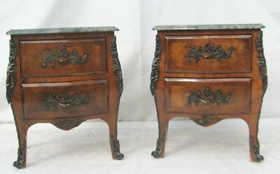 A pair of Marble topped Bombe Bedside Chests