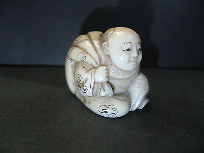 Real Japanese Netsuke Cattle Bone Oriental Child has Large Bag carved in Edo era
