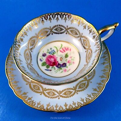 Gold Design on Blue Background with Floral Center Paragon Tea Cup and Saucer Set