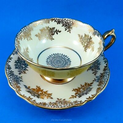 Gold Design with Yolk Yellow & Gold Handle Exterior Paragon Tea Cup and Saucer