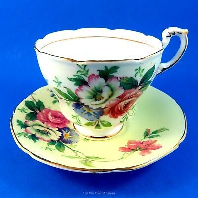 Pretty Floral Bouquet on Pale Yellow Paragon Tea Cup and Saucer Set