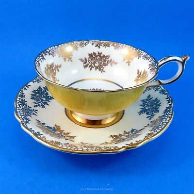Gold Design on Beige with Bright Yellow Exterior Paragon Tea Cup and Saucer Set