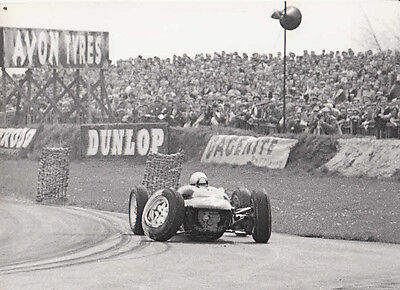 Single Seater Racing Car, With One Rear Wheel Hanging Off, Photograph.