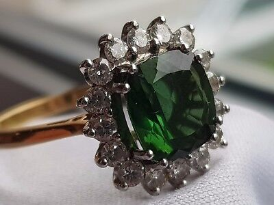 Green tourmaline and diamond 18K gold Princess Diana style engagement ring