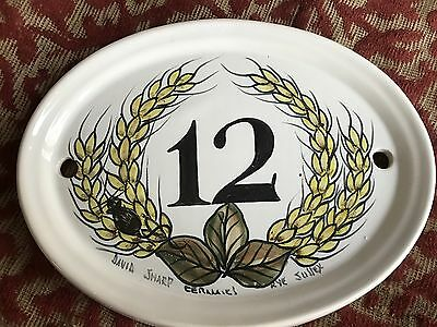 1980s handpainted ceramic house sign from rye in sussex .number 12