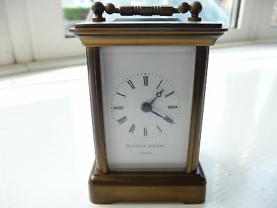 A Superb Matthew Norman Minature Brass Swiss Made Carriage Clock