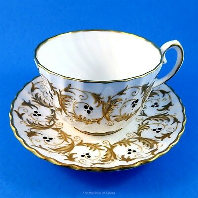 """Stunning Raised Gold with Black Enamel """" Scroll """" Gladstone Tea Cup and Saucer"""
