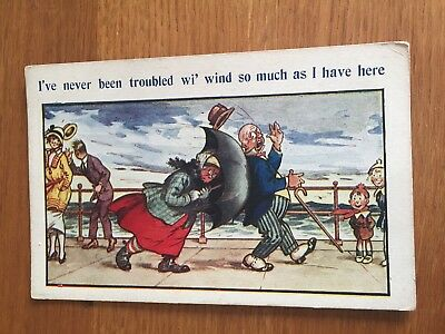 Postcard Bamforth  Comic Lady with wind at seaside and unbrella