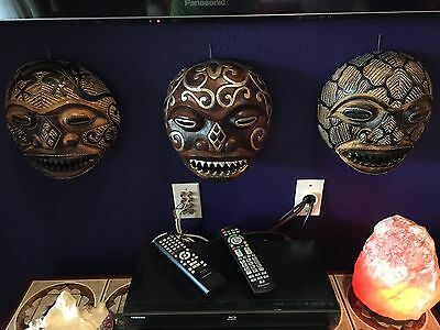 Set Of Three Hand Carved and Painted African Masks.