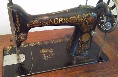 Singer 'Red Eye' Treadle Sewing Machine, 7 Drawer Cabinet, carved wood drawers.