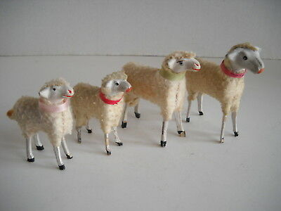 4 antique wool sheeps, wood stick legs, Germany