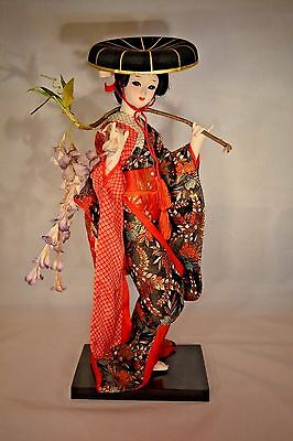 14 inch Japanese Nishi Doll Carrying Wisteria Branch