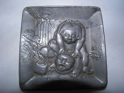 Japanese Meiji Period Lead or Pewter Dish with Comical Scene of Man with Animal