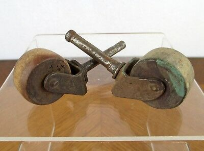 Vintage Pair of Small Metal and Wood Industrial Peg Mounted Roller Caster Wheels