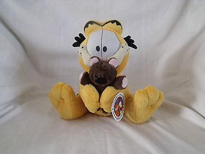 Garfield soft / plush toy holding small bear 24 cm tall with tag.  P1