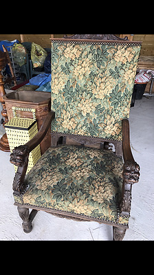 Antique French chair with lion head decoration