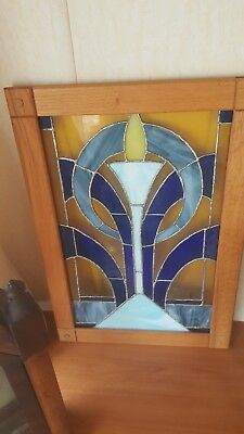 stained glass panel framed in oak