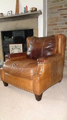 Big, brown, leather easy chairs (vintage/retro)