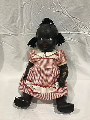 Antique doll with original clothes - early 1900's