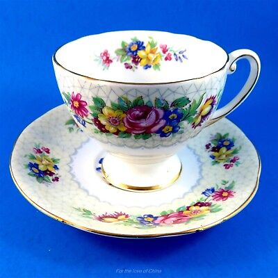 Striking Floral Border on Pale Yellow Royal Standard Tea Cup and Saucer Set