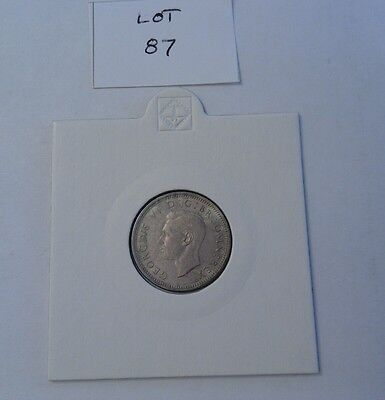 Scarce 1938 George VI silver sixpence, uncirculated. (Lot 87).