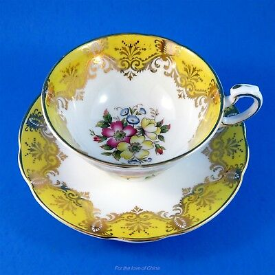 Striking Yellow and Gold Border with Floral Center Paragon Tea Cup and Saucer